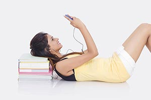 College Young Woman Student Listening Music on her
