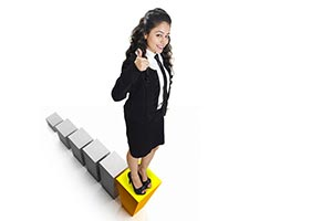 1 Businesswoman Standing In Graph Blocks Showing T