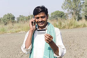 Rural Farmer Field Credit Card Talking Phone