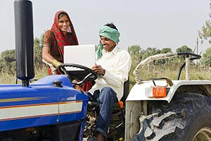 Farmer Couple Sitting Tractor Using Laptop