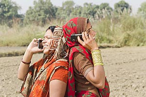 Rural Womans Back To Back Talking Phone