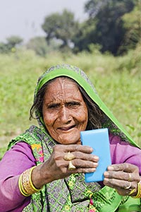 Rural Senior Woman Messaging Phone