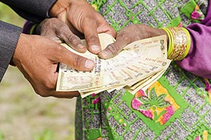 Businessman Rural Woman Giving Money