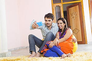 2 Indian Married Couple Sitting At Home Taking Sel