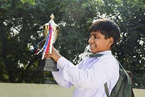 Smiling 1 Rural Kid school boy watching Trophy Vic