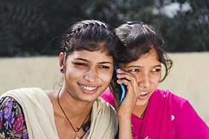 2 Indian Rural Girls Talking On Mobile Phone and S