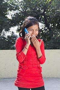 Surprised 1 Indian Rural Kid Girl Talking On Mobil