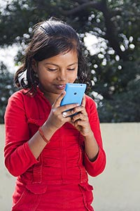 1 Indian Rural Little Girl Reading Text Message Ph