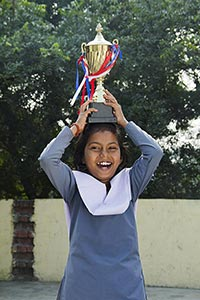 1 Indian Rural Kid Student Holding Trophy On Head