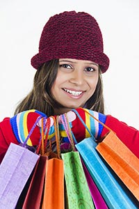 Happy Indian teenage girl Winter clothes shopping