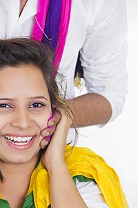 Couple celebrating Holi colors Applying Face