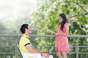 Couple At Home Sitting Balcony Man Using laptop An