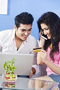 Couple Home Using Laptop Online Shopping Credit ca