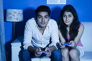 Couple Sitting Sofa Home Playing Video game Hobby