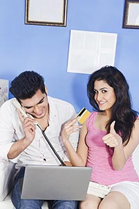 Couple Home Laptop Talking Telephone DebitCard Onl