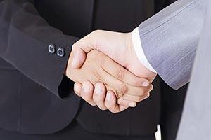 Business Partners Handshake Dealing
