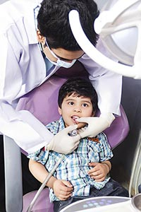Dental examination and teeth cleaning Boy