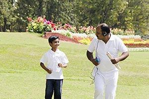 Indian Grandfather And Grandson Morning Walk Joggi