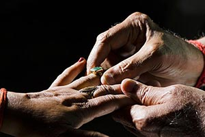 Romantic Old Couple Putting Anniversary Ring Hands