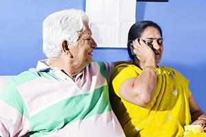 Indian Senior Couple At Home Talking Phone