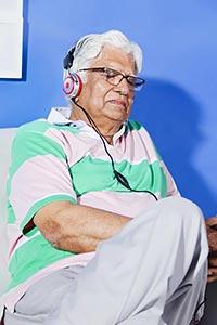 Indian Senior Man home Sleeping Hearing Music