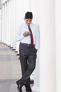 Businessman Standing Using Phone Happy