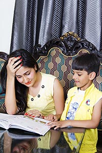 Mother Son Studying At Home