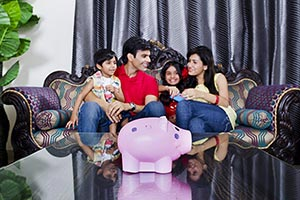 Family Saving Money Piggybank