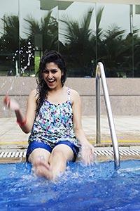 Woman Splashing Water Swimming pool