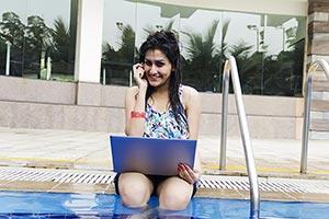 Woman Talking Phone Laptop Swimming pool