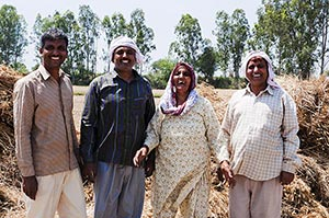 Indian Rural Farmer Family Standing Together Field