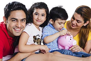 Indian Family Saving Money Piggybank