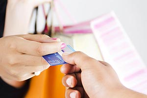Woman Giving Credit card Shopkeeper