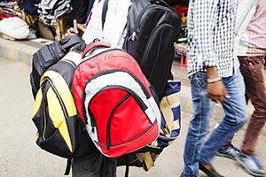 3-5 People ; Abundance ; Adult Man ; Bag ; Carryin