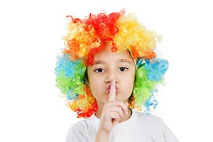 Kid Girl in colorful bright wig doing silence gest