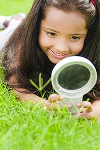 Little Girl Lying Grass Park Magnifying Glass Rese