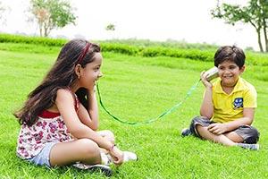 Kids Boy Girl Sitting Park Playing Hearing Toy Pho