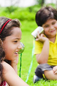 Children Boy Girl Sitting Park Playing Hearing Toy