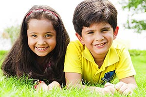 Kids Boy Girl Lying Grass Relaxing Smiling enjoyin