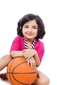 Little Girl Sitting Floor Holding Basketball