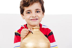 Child Boy Inserting Coin Saving Money Piggybank