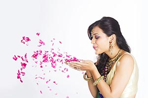 Indian Beautiful Woman Blowing Rose
