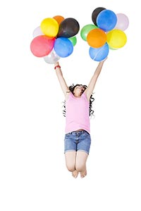 Happy Teen Girl jumping with colorful balloons Hav