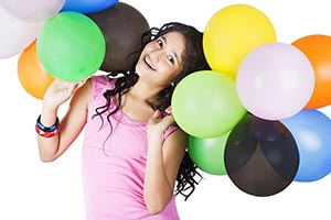 Happy Indian Young Girl playing with Bunch balloon