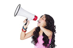 Indian Teenage girl shouting through megaphone Ann