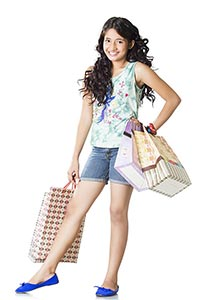 Indian Teenage girl with shopping bags Smiling