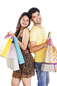Couple Showing Credit card Shopping Bags