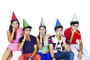 Teenagers Friends Blowing Horn Birthday Party Cele