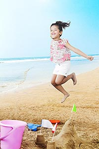 sandcastle1 Little Girl Jumping on the beach Havin