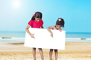 2 Kids Girls Holding Message Board On Beach Pointi
